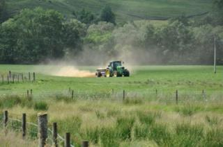 Tractor spraying fields
